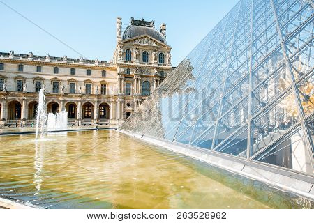 Paris, France - September 01, 2018: View On The Louvre Museum With Glass Pyramids, The Worlds Larges