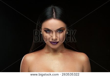 A Beautiful Woman In A Silk Top With Beautiful Long Dark Hair. Black Background.fashion, Beauty, Mak