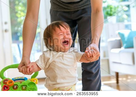 Upset Toddler Boy Crying In His House With His Father