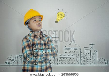 Little Asian Boy Engineering With Creative Plan Against Drawing Of City Plan In The Future, Kid Crea