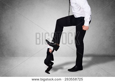 Composite Image, Bad Leadership Conflict Concept. Big Boss Trying To Stomping Step On His Small Work