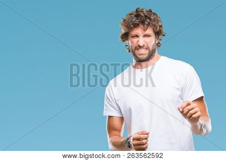 Handsome hispanic model man over isolated background disgusted expression, displeased and fearful doing disgust face because aversion reaction. With hands raised. Annoying concept.