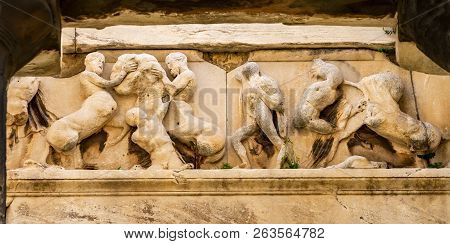 Ancient Temple of Hephaestus Battle Centaurs Sculpture Columns Agora Market Place Athens Greece. Agora founded 6th Century BC. Temple for God of craftsmanship, metal working from 449 BC, later church poster
