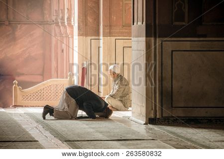 Religious Muslim Man Praying Inside The Mosque. Two Older Muslims At The Great Friday Mosque Jami Ma