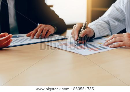 Business People Talking And Analysis Finance Cost With Checking Reports.