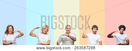 Collage of group of young and middle age people wearing white t-shirt over color isolated background gesturing with hands showing big and large size sign, measure symbol. Smiling looking at the camera