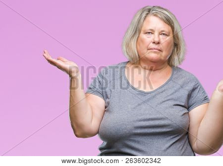 Senior plus size caucasian woman over isolated background clueless and confused expression with arms and hands raised. Doubt concept.