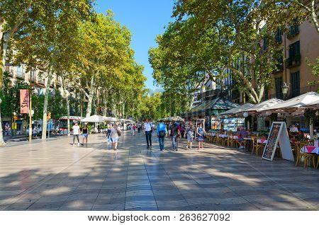 Barcelona, Spain - September 13, 2018: Unidentified People Walk Along Famous Pedestrian Street La Ra