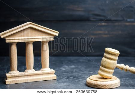Government Building And Judge's Hammer. Concept Of State Administration And Economic Institutions. M