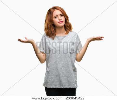 Young beautiful woman over isolated background clueless and confused expression with arms and hands raised. Doubt concept.