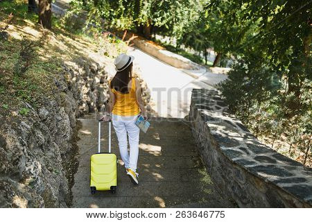 Back Rear View Traveler Tourist Woman In Yellow Summer Casual Clothes Hat With Suitcase City Map Wal