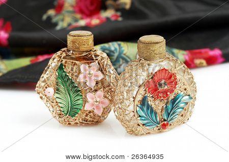 Vintage perfume bottles and scarf