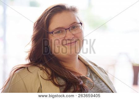 Close Up Portrait Of Beautiful Plus Size Young Adult Woman, With Brown Hair And A Beige Blazer, Whil