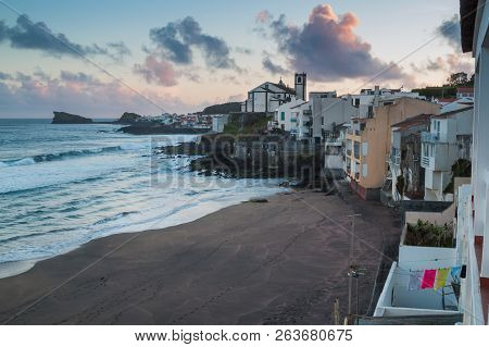 View On The Beach, Atlantic Ocean And Part Of Ponta Delgada With A Church On A Hill. Cloudy Evening