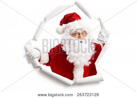 Santa Claus emerging from a paper hole isolated on white background