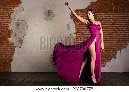Fashion Model Art Dress, Elegant Woman Standing In Purple Retro Gown, Silk Fabric Fluttering Over Br
