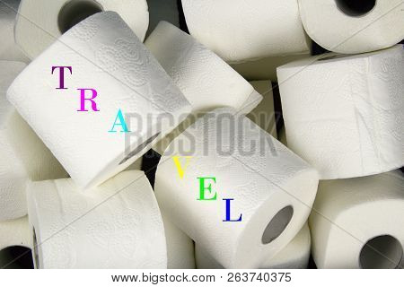 Many Rolls Of White Toilet Paper. A Matter Of Daily Necessity With Inscription Travel.detail Of Toil