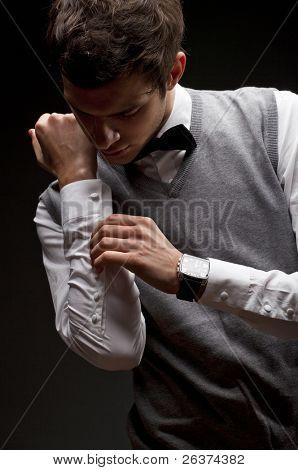 elegant man buttoning his shirt