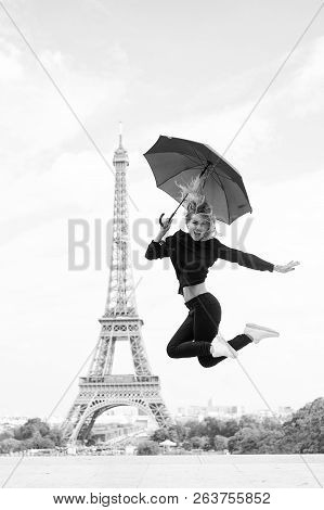 Lady With Umbrella Excited About Visiting Eiffel Tower, Sky Background. Lady Tourist Sporty And Acti