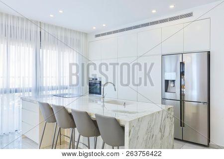 Modern Design Of Luxury White Kitchen With Marble Island