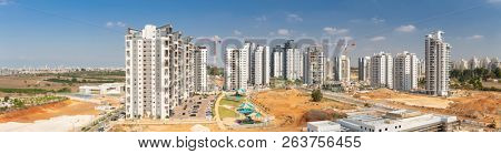New residential district in Beer Yaakov with new tall buildings and site construction, Israel - Panoramic Shot