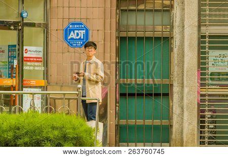 Samcheok, South Korea; September 24, 2018: Young Unidentified Korean Man In Front Of Glass Doorway H