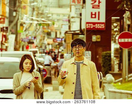 Samcheok, South Korea; September 24, 2018: Young Unidentified Korean Couple Woman Using Cellphone An