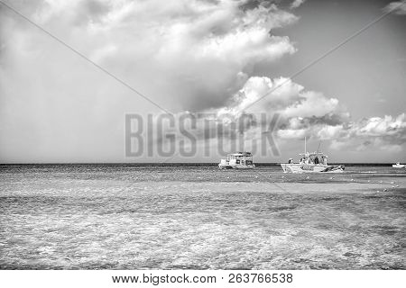 Grand Turk, Turks And Caicos Islands - December 29, 2015: Powerboats In Turquoise Sea On Cloudy Sky.