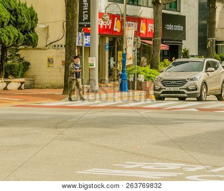 Samcheok, South Korea; September 24, 2018: Young Unidentified Korean Man Looking At His Cellphone As