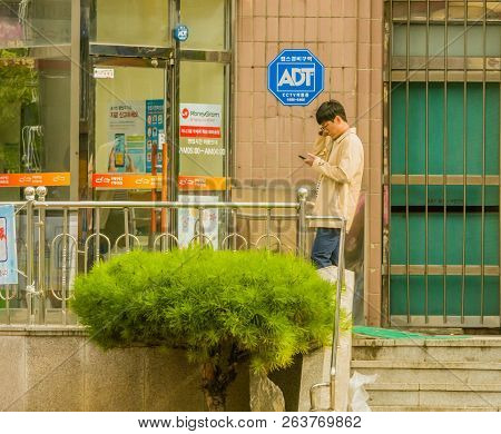 Samcheok, South Korea; September 24, 2018: Young Unidentified Korean Man Standing In Front Of Glass