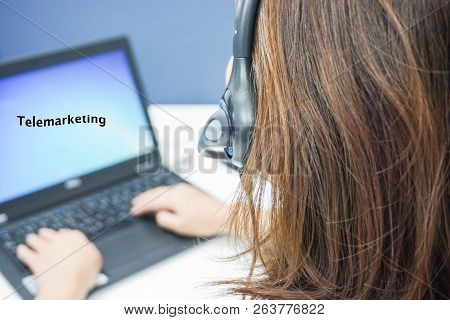 Woman Callcenter With Headset On Job With Laptop