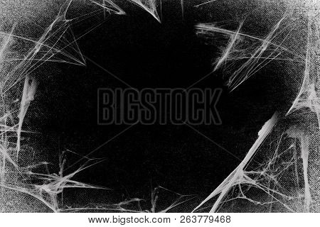 Spiderwebs Isolated On Black Grunge Background. Cobweb In The Corner.  Halloween Party. Texture Of S