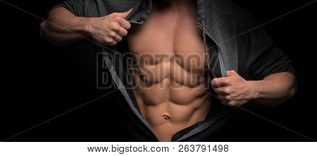 Handsome Shape Man With Muscular Body. Closeup Of Fit Young Mans Abdomen Against Dark Background