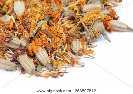 Dry Marigold Petals On White Background. Close-up View