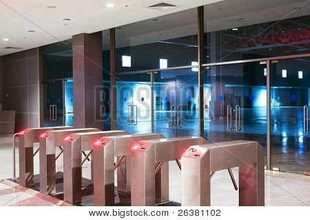 Turnstiles at entrance of modern building
