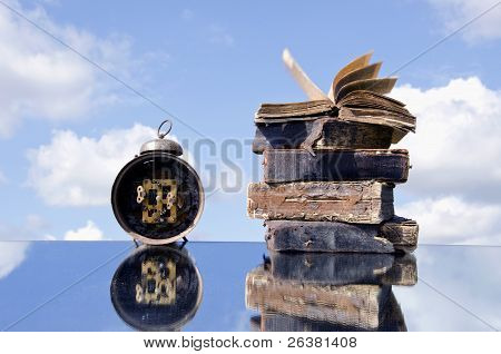 Vintage Books And Old Clock On Mirror