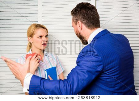 Tense Conversation Or Quarrel Between Colleagues. Boss And Worker Discuss Working Plan. Prejudice An