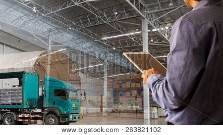 Businessman Manager Using Tablet Check And Control For Workers With Warehouse And Cargo Transport Or