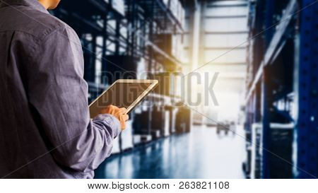 Businessman Manager Using Tablet Check And Control For Workers With Modern Trade Warehouse Global Bu