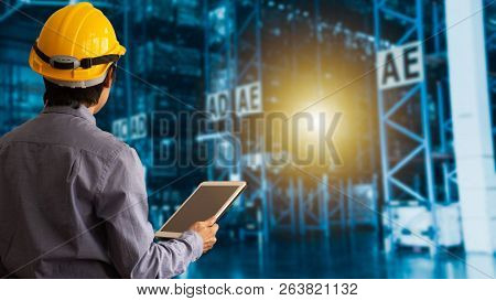 Engineer Manager Wearing Hard Hat Using Tablet Check And Control For Workers With Warehouse Logistic