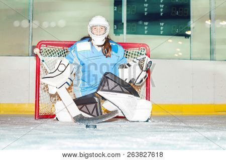 Girl Goaltender Crouches In Crease To Protect Net