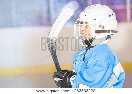 Young Hockey Player Preparing To Go Out On Rink