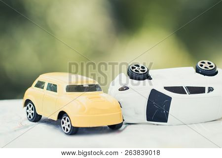 Vehicle Insurance Car Accident Concept : Two Miniature Cars Accidents Crash On Road, Broken Toys Aut