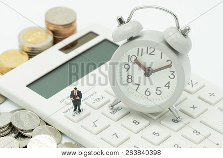 Miniature People Pay Queue Annual Income (tax) For The Year Tax Time Watches Put On The Wood Word Ta