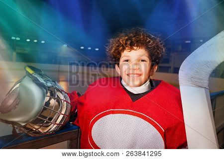 Happy Hockey Player Standing Next To The Boards