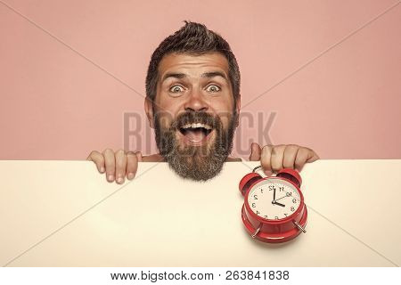Man With Beard Hold Alarm Clock. Time Management And Business Success. Hipster With Red Clock On Pin