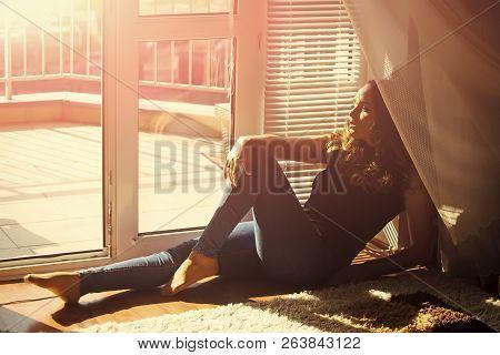 Girl In Jeans Relax On Floor At Door Window Indoor. Fashion, Beauty, Look, Makeup. Daydreaming, Leis