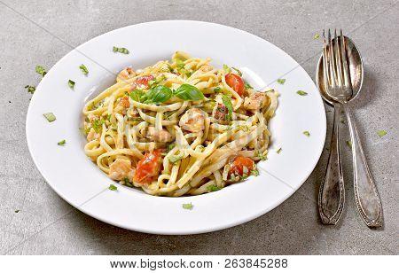Delicious Salmon Pasta Dish, Tagliatelle Or Linguine Noodles. High Angle View Of Fresh Spaghetti Pas