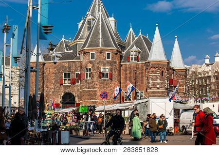 Amsterdam, Netherlands - March, 2018: The Nieuwmarkt Square Daily General Goods Market In The Old Ce