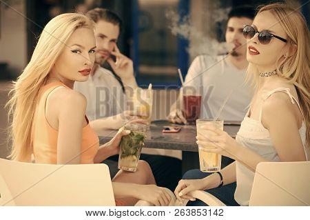 Women Twins And Men Friends Relax In Cafe Outdoor. Man Vapor Hookah Pipe In Shisha Bar Lounge. Celeb